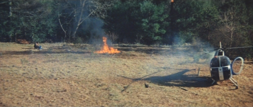 The burning bear remains are not aligned with the position of Don's body and the location where Kelly fired and then subsequently dropped the bazooka. I guess the blast knocked it aside. Yeah right.