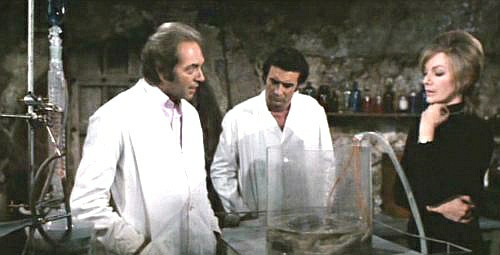 """For the last time, we're not chefs! We wear white because we're scientists! That's our experiment and not a Soufflé."""